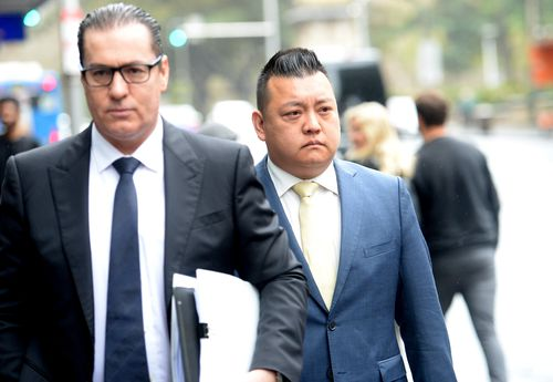 NSW Labor's community relations director Kenrick Cheah (right) arrives at the ICAC public inquiry into allegations concerning political donations, Sydney.