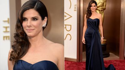 Sandra Bullock is sleek and stunning in a draped navy gown.