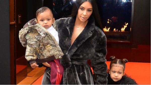 Kim Kardashian with daughter North, now four, and son Saint, now two. Image: Getty.