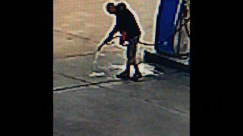 CCTV footage shows petrol being hosed onto the service station driveway.