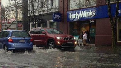 Flash flooding slows traffic in Burwood Rd, Hawthorn. (9NEWS)
