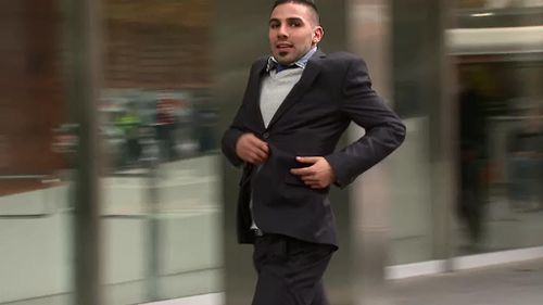 John Wassouf running into court in Melbourne today. (9NEWS)