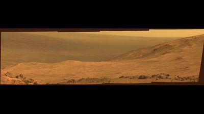 "A new stretch of Mars' dusty red landscape has been revealed in an image taken by NASA's Rover Opportunity vehicle.  The panoramic still shows part of the ""Red Planet's"" Marathon Valley, on the western rim of the Endeavour Crater."