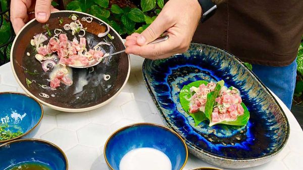 Raw tuna and lemongrass on betel leaves