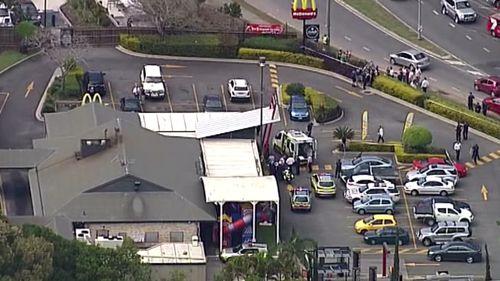 Police at the scene in Helensvale. (9NEWS)