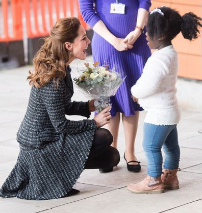 Kate accepting a posy from Anna-Victoria, nine.