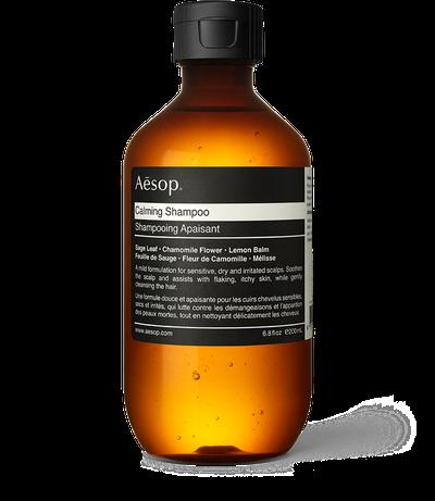 """Aesop <a href=""""https://www.aesop.com/au/p/hair/hair-cleanse/calming-shampoo/"""" target=""""_blank"""">Calming Shampoo</a>, $29<br>"""