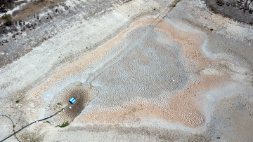 An aerial view of a dried up dam at Cottonvale apple orchard, outside of Stanthorpe.