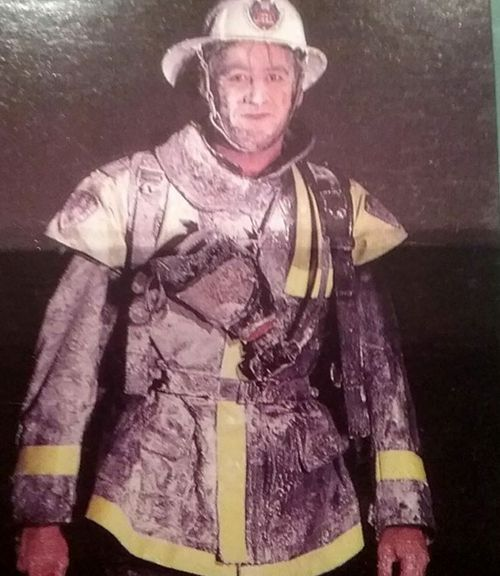 A firefighter covered in foam. (Photo: Supplied).