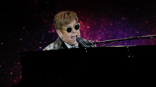 British musician and composer Elton John performs at a press conference in New York, New York. (AAP)