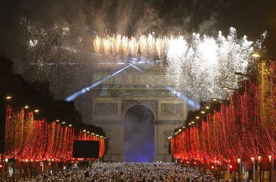 Fireworks illuminate the sky over the Arc de Triomphe during the New Year's Day celebrations on the Champs Elysees, in Paris.