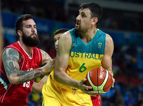 Miroslav Raduljica of Serbia (left) looks to take possession off Andrew Bogut (right) during the Men's Basketball Semifinal between Australia and Serbia in 2016. (AAP)