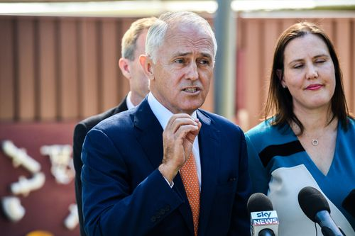 Malcolm Turnbull (centre) speaks to the media during a visit to the Teenie Weenies Learning Centre in Panania today. (AAP)