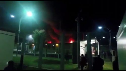 The chaos began at around 8.45pm when tensions between guards and detainees boiled over.