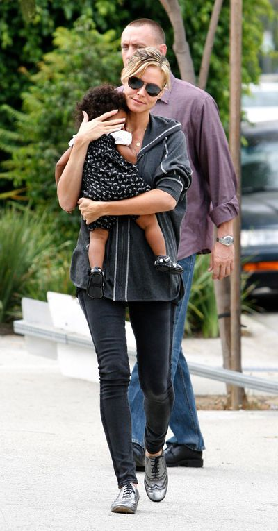 <p>Heidi Klum sporting silver brogues in 2010 - she's carrying baby daughter Lou on her way to pick up her other daughter Leni, in California.</p>