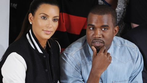 Kimye family values! Kanye 'proposes' to new baby mama Kim