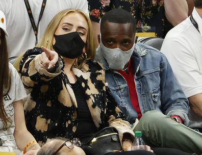 Singer Adele looks on next to Rich Paul during the first half in Game Five of the NBA Finals between the Milwaukee Bucks and the Phoenix Suns at Footprint Center on July 17, 2021 in Phoenix, Arizona.