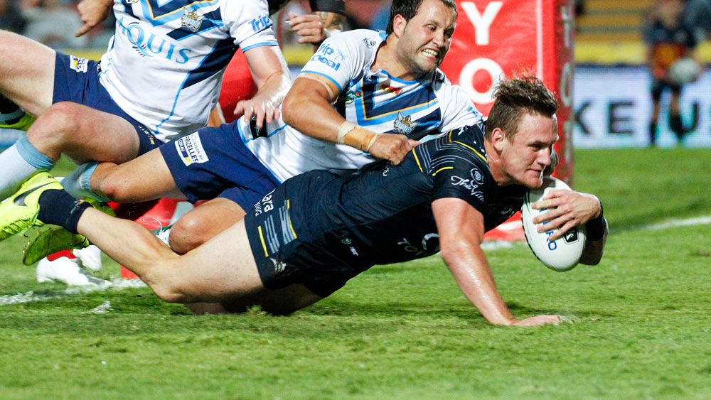 Coen Hess crosses for a try for the Cowboys in their win over the Titans. (AAP)