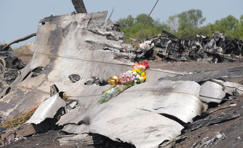 Flowers laid at the MH17 crash site by the Australian parents of 25-year-old Fatima Dyczynski. (Getty)