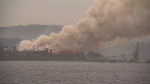A fire is still burning in Eden, on the NSW South Coast.