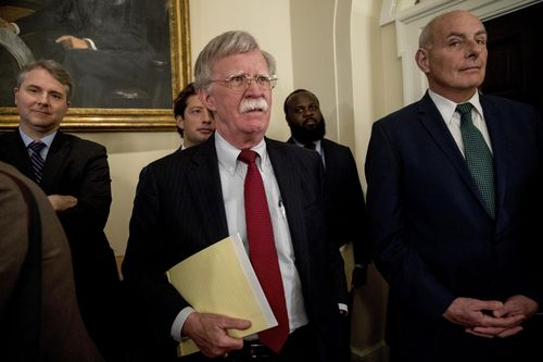 National security adviser John Bolton watches on as Mr Trump defended his comments. Picture: AAP