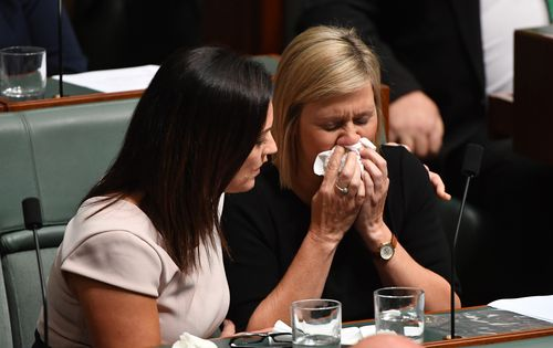 Labor member Emma Husar consoles Susan Lamb (right) after her tearful speech to  Parliament (AAP ).