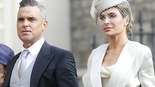 British singer Robbie Williams arrives with his wife Ayda Fields, right, and his mother-in-law Gwen Fields for the wedding of Princess Eugenie of York and Jack Brooksbank at St George's Chapel, Windsor Castle.
