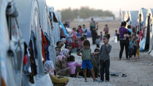 Syrian refugees are seen at a refugee camp after they fled from ISIL violence. (AAP)