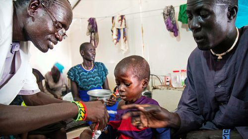 A medical officer from Doctors Without Borders (MSF) attends to a child with malnutrition in a clinic in Old Fangak, Jonglei state, South Sudan. (Image: AFP)