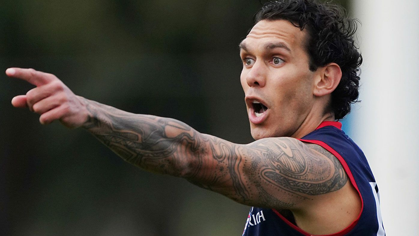 Harley Bennell runs with the ball during an AFL Melbourne Football Club training session