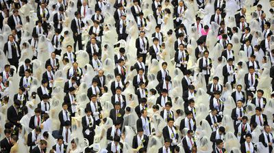 "<p>Why get married on your own when you can be one of thousands of couples submitting to the will of a cult? Well, plenty of good reasons, but none of them occurred to these couple where part of a mass ""moonie"" wedding in South Korea's Cheongshim Peace World Center on February 17, 2013.</p>"