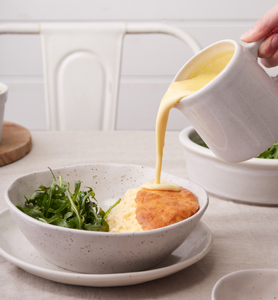Goat's cheese souffle with creamy lemon cheese sauce