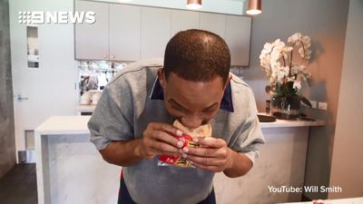 Will Smith tries his first Australian meat pie, and his reaction is priceless