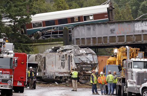 Trucks and cars were tangled in the devastation from the truck crash, (AAP)