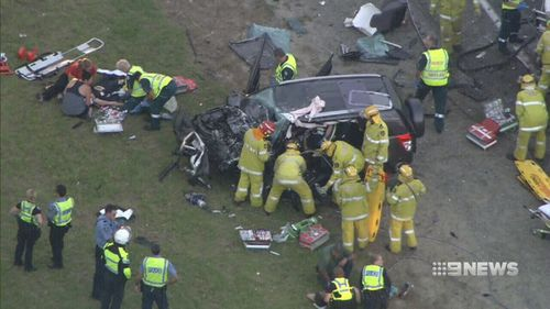 Police pulled two people from the wreckage and they were taken to hospital. (9NEWS)
