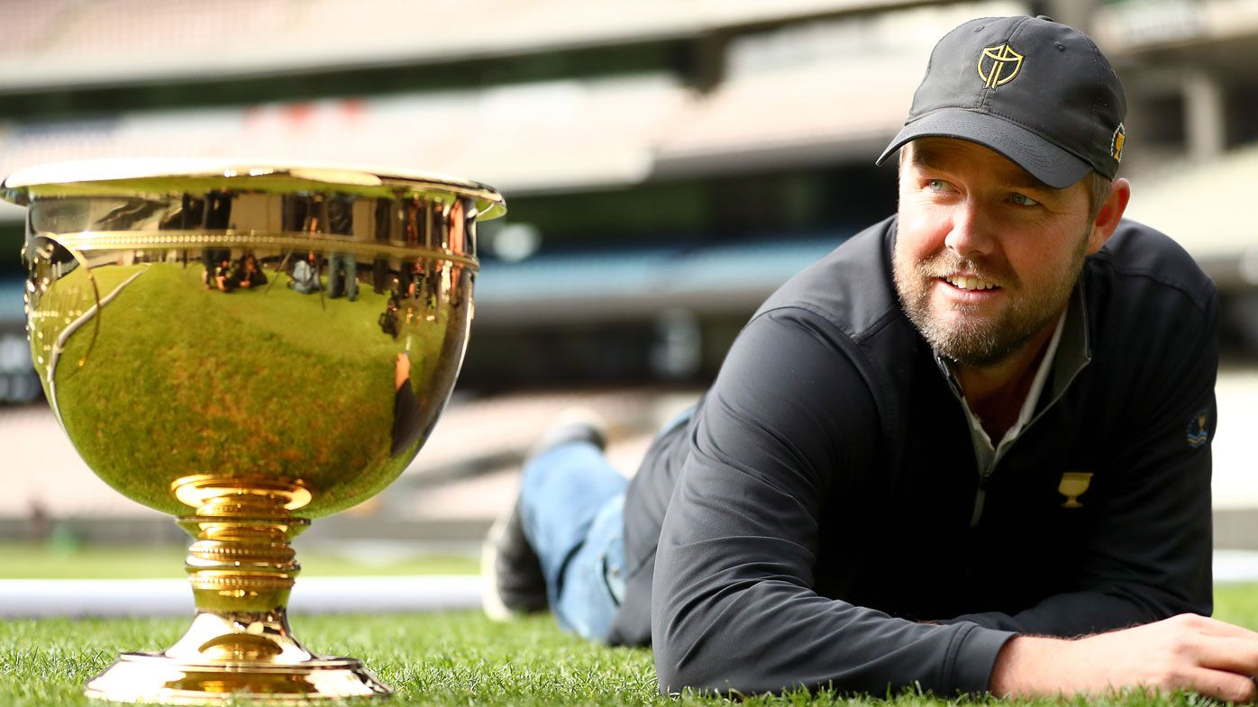 Marc Leishman cuts the grass on the MCG ahead of the 2019 Presidents Cup