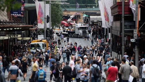 Trucks block traffic from entering Market Street in Sydney's CBD. (Image: AAP)