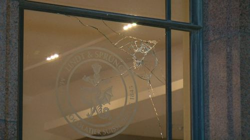 At least six rocks were thrown at the glass. (9NEWS)