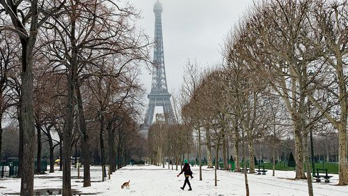 The Eiffel Tower is closed to visitors after heavy snow covered the wrought iron structure. (Photo: AP).