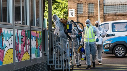Cleaners at Bondi Beach Public School after a positive case was recorded there.