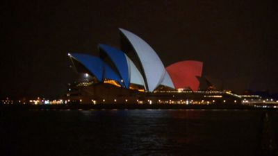 <p>Sydney's iconic opera house was been bathed in coloured light as a mark of respect. (9NEWS)</p>