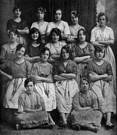 "The photo is described as ""some happy Ulster girls from a linen factory of North Ireland's chief city."""