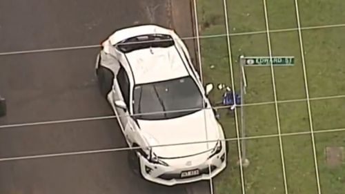 The pair fled Stringybark Street in a white coupe. (9NEWS)