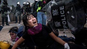 A pro-democracy protester screams out as she is tackled and arrested by police during clashes after a march on September 29, 2019 in Hong Kong, China. Pro-democracy demonstrations have entered its fourth month as Hong Kong braces for the 70th anniversary of the founding of the People's Republic of China with a series of pro and anti-Beijing protests scheduled towards October 1.