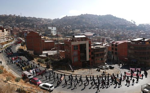 Demonstrators protest against the government's response to the COVID-19 pandemic in La Paz, Bolivia