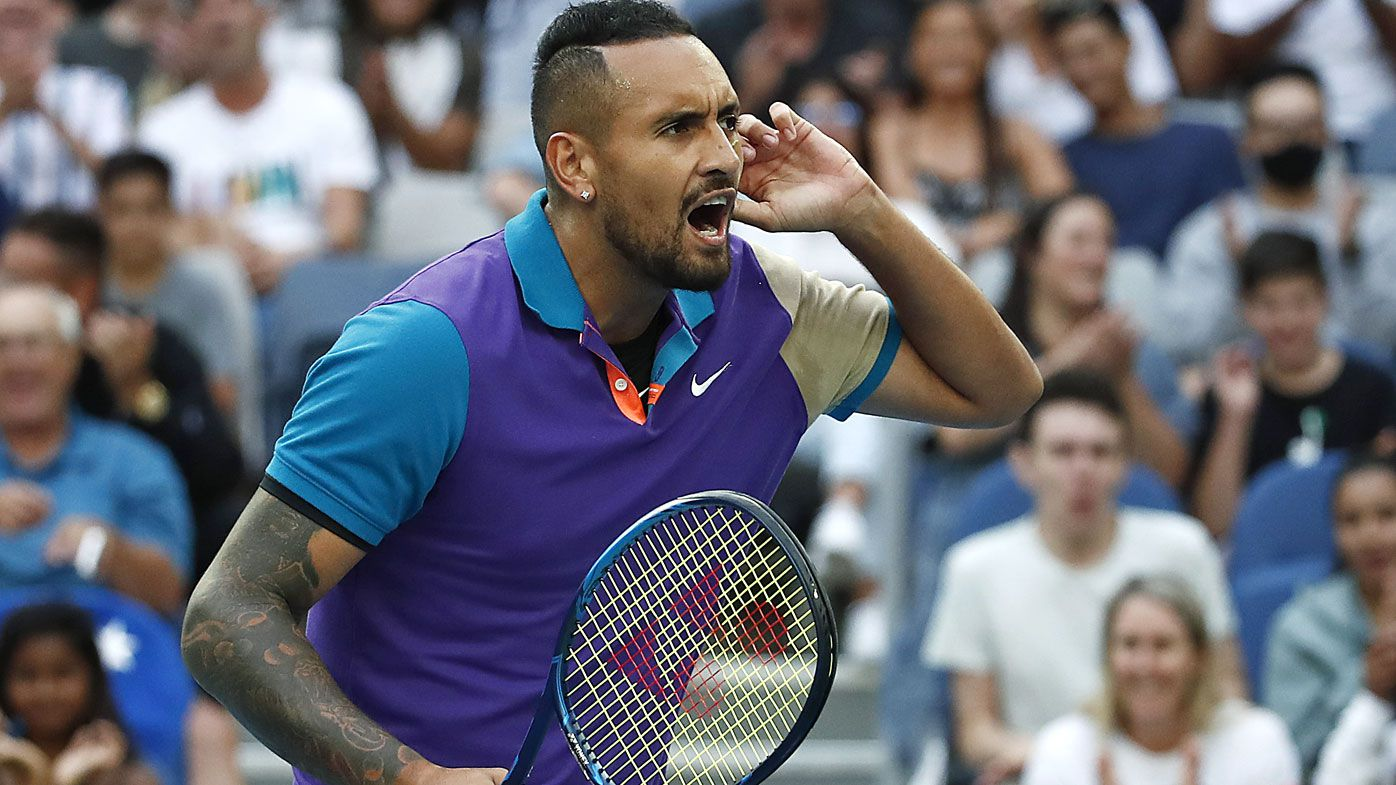 Nick Kyrgios of Australia celebrates after winning a point in his Men's Singles third round match against Dominic Thiem of Austria during day five of the 2021 Australian Open at Melbourne Park on February 12, 2021 in Melbourne, Australia