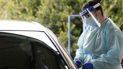 Medical professionals perform COVID testing at a drive through clinic in Ballarat, Victoria.