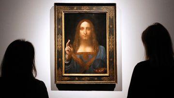 "People gather around Leonardo da Vinci's ""Salvator Mundi"" on display at Christie's auction rooms in London, in 2017."