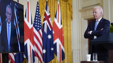 President Joe Biden, listens as he is joined virtually by Australian Prime Minister Scott Morrison and British Prime Minister Boris Johnson, not seen, as he speaks about a national security initiative from the East Room of the White House in Washington.
