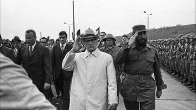In this June 1972  photo, Cuba's leader Fidel Castro, right, reviews troops during his visit to Leuna, formerly the German Democratic Republic. (AAP)